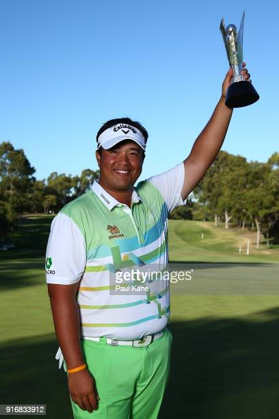 Kiradech Aphibarnrat of Thailand holds the trophy after winning the final match against James Nitties of Australia during day four of the World Super...
