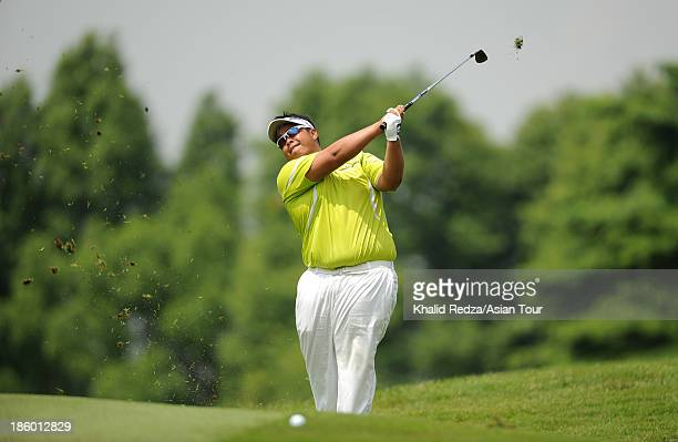 Kiradech Aphibarnrat of Thailand in action during round four of the CIMB Classic at Kuala Lumpur Golf & Country Club on October 27, 2013 in Kuala...