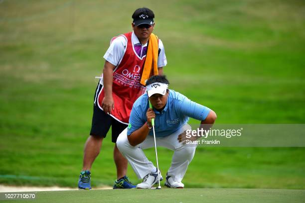 Kiradech Aphibarnrat of Thailand lines up a putt on the 11th hole during day one of the Omega European Masters at CranssurSierre Golf Club on...