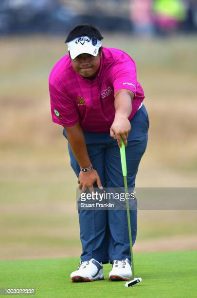 Kiradech Aphibarnrat of Thailand lines up a putt on the 16th green during the third round of the 147th Open Championship at Carnoustie Golf Club on...