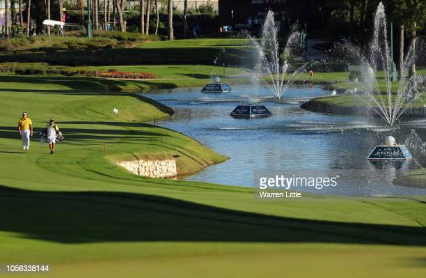 Kiradech Aphibarnrat of Thailand makes his way down the 18th with his caddie during Day Two of the Turkish Airlines Open at the Regnum Carya Golf Spa...