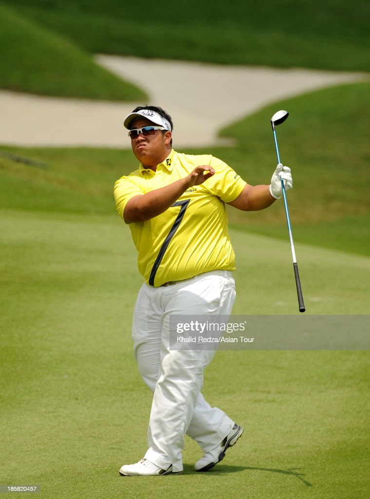 Kiradech Aphibarnrat of Thailand plays a shot during round two of the CIMB Classic at Kuala Lumpur Golf & Country Club on October 25, 2013 in Kuala Lumpur, Malaysia.