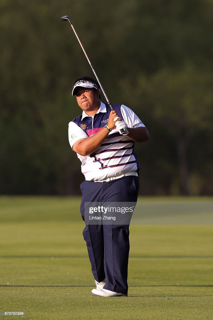 Kiradech Aphibarnrat of Thailand plays a shot during the first round of the 2017 Volvo China open at Topwin Golf and Country Club on April 27, 2017 in Beijing, China.