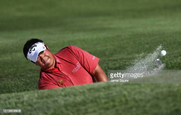 Kiradech Aphibarnrat of Thailand plays a shot from a bunker on the fourth hole during the first round of the 2018 PGA Championship at Bellerive...