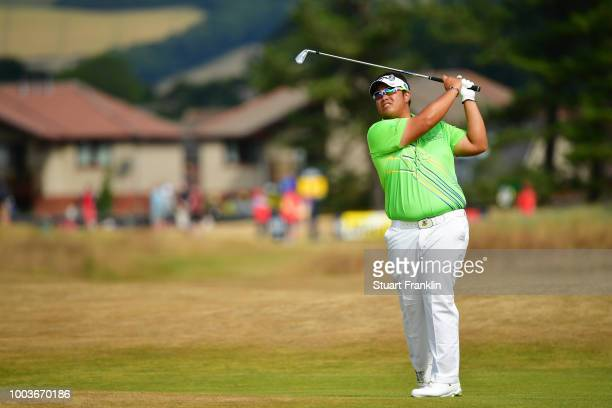 Kiradech Aphibarnrat of Thailand plays a shot on the 12th hole during the final round of the 147th Open Championship at Carnoustie Golf Club on July...