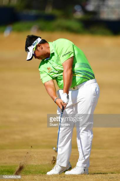 Kiradech Aphibarnrat of Thailand plays a shot on the 14th hole during the final round of the 147th Open Championship at Carnoustie Golf Club on July...
