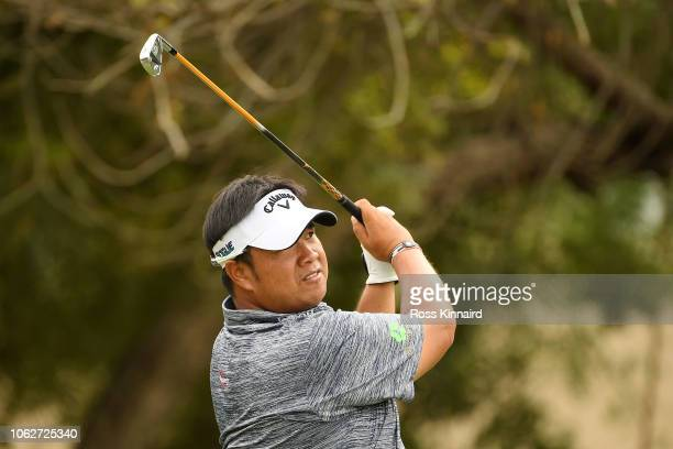 Kiradech Aphibarnrat of Thailand plays a shot on the 14th hole during day three of the DP World Tour Championship at Jumeirah Golf Estates on...