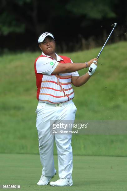 Kiradech Aphibarnrat of Thailand plays a shot on the 18th fairway during the first round of the Quicken Loans National at TPC Potomac on June 28 2018...
