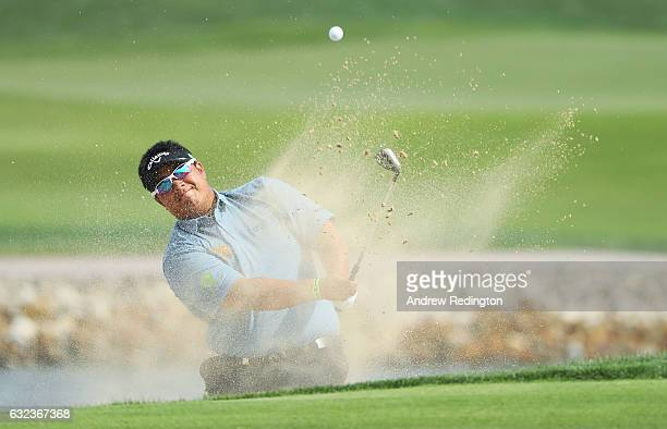 Kiradech Aphibarnrat of Thailand plays from a bunker on the 6th hole during the final round of the Abu Dhabi HSBC Championship at Abu Dhabi Golf Club...