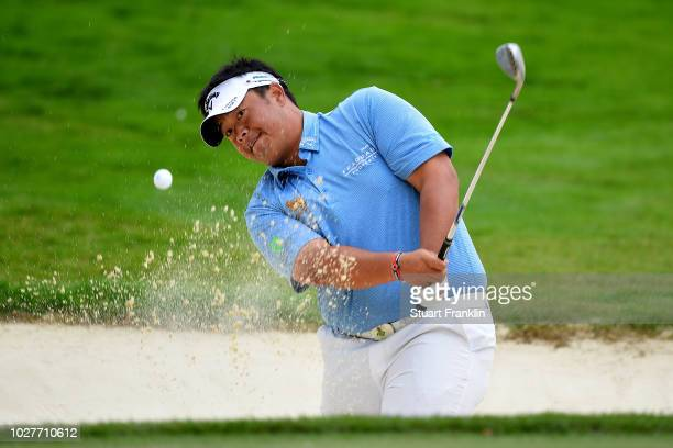 Kiradech Aphibarnrat of Thailand plays from the sand on the 11th hole during day one of the Omega European Masters at CranssurSierre Golf Club on...