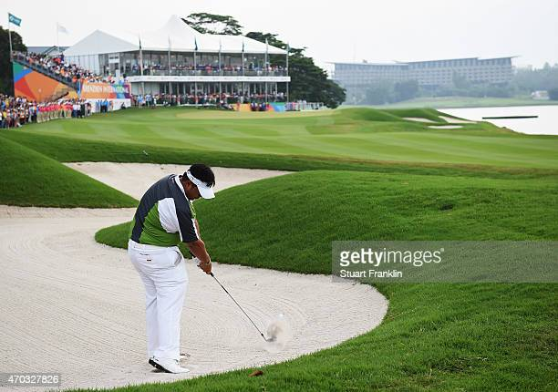 Kiradech Aphibarnrat of Thailand plays his approach shot on the 18th hole during the final round of the Shenzhen International at Genzon Golf Club on...
