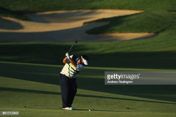 Kiradech Aphibarnrat of Thailand plays his second shot on the 10th hole during day two of the Portugal Masters at Dom Pedro Victoria Golf Club on...