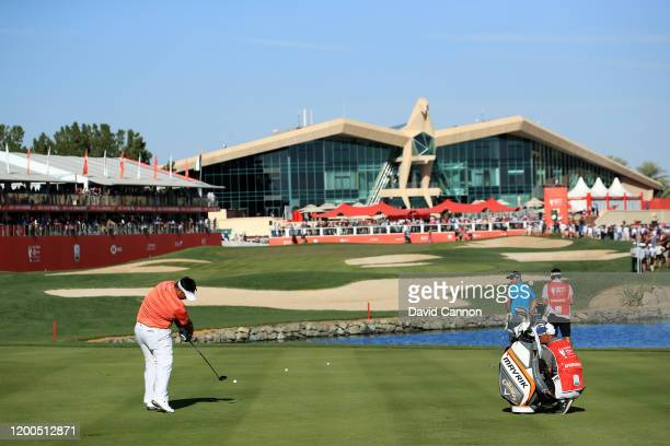 Kiradech Aphibarnrat of Thailand plays his second shot on the 18th hole during the final round of the Abu Dhabi HSBC Championship at Abu Dhabi Golf...