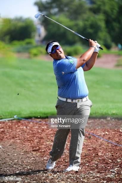 Kiradech Aphibarnrat of Thailand plays his second shot on the 1st hole during day one of the DP World Tour Championship at Jumeirah Golf Estates on...