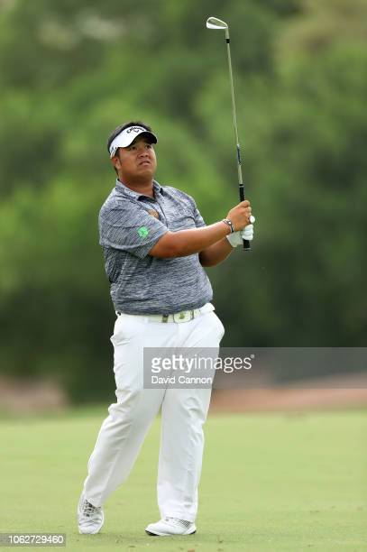 Kiradech Aphibarnrat of Thailand plays his second shot on the par 4 third hole during the third round of the DP World Tour Championship on the Earth...
