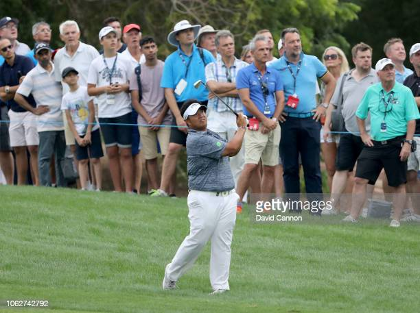 Kiradech Aphibarnrat of Thailand plays his second shot on the par 5 18th hole during the third round of the DP World Tour Championship on the Earth...