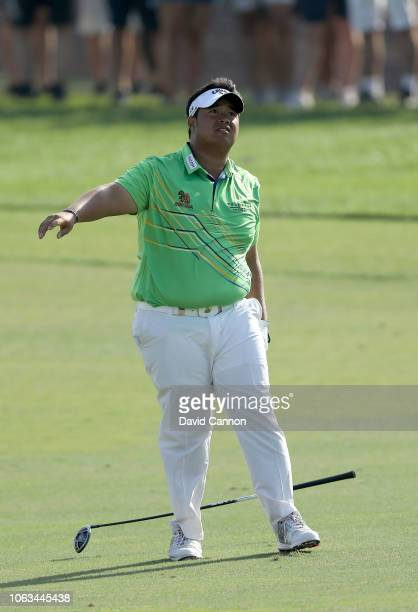 Kiradech Aphibarnrat of Thailand plays his second shot on the par 5 18th hole during the final round of the DP World Tour Championship on the Earth...