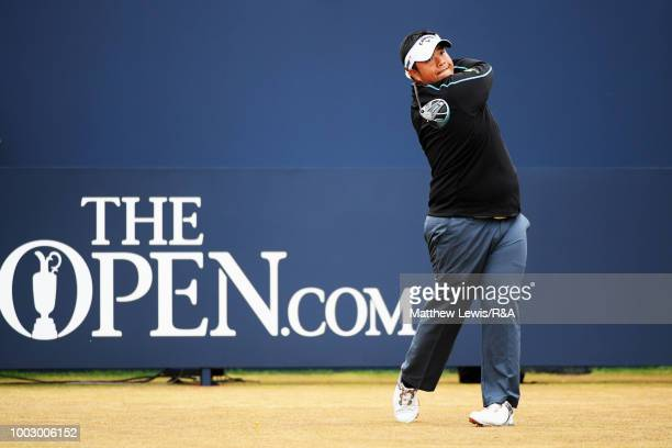Kiradech Aphibarnrat of Thailand plays his shot from the first tee during round three of the Open Championship at Carnoustie Golf Club on July 21...