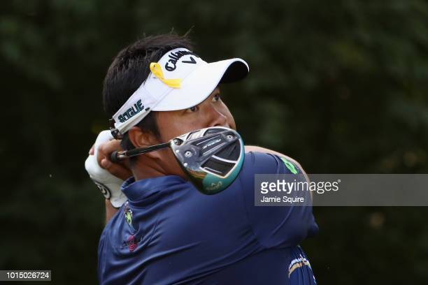 Kiradech Aphibarnrat of Thailand plays his shot from the ninth tee during the continuation of the weather delayed second round of the 2018 PGA...