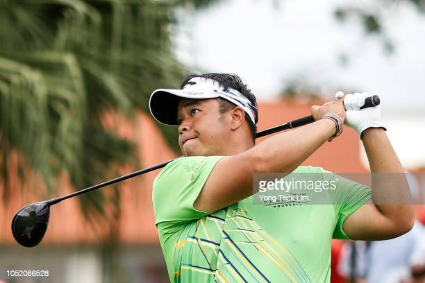 Kiradech Aphibarnrat of Thailand plays his shot on the first tee during the final round of the CIMB Classic at TPC Kuala Lumpur on October 14 2018 in...