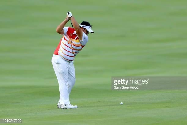 Kiradech Aphibarnrat of Thailand plays his shot on the second hole during World Golf ChampionshipsBridgestone Invitational Round Two at Firestone at...