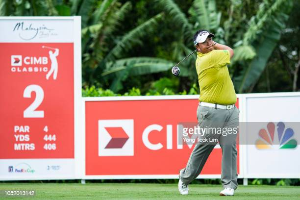 Kiradech Aphibarnrat of Thailand plays his shot on the second tee during round three of the CIMB Classic at TPC Kuala Lumpur on October 13 2018 in...