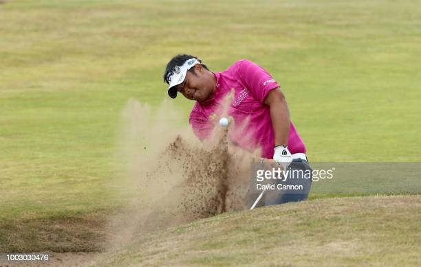 Kiradech Aphibarnrat of Thailand plays his third shot on the 18th hole during the third round of the 147th Open Championship at Carnoustie Golf Club...