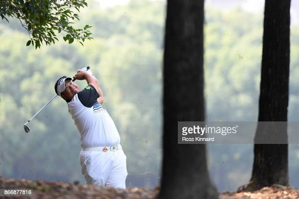 Kiradech Aphibarnrat of Thailand plays his third shot on the eighth hole during the second round of the WGC HSBC Champions at Sheshan International...