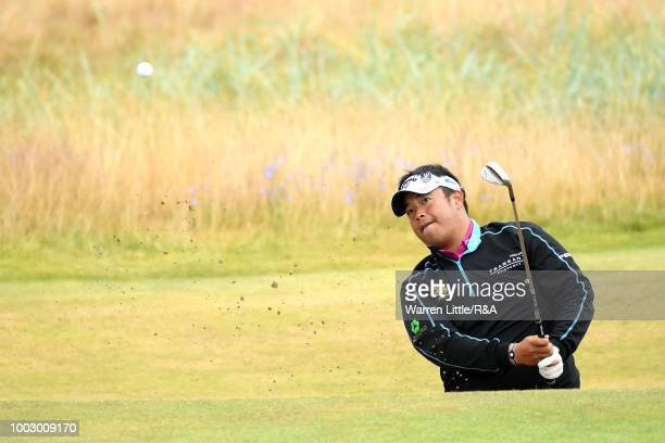 Kiradech Aphibarnrat of Thailand plays out greenside bunker on the 4th hole during round three of the Open Championship at Carnoustie Golf Club on...