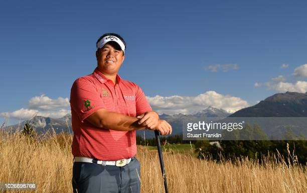 Kiradech Aphibarnrat of Thailand poses for a picture during practice prior to the start of Omega European Masters at CranssurSierre Golf Club on...