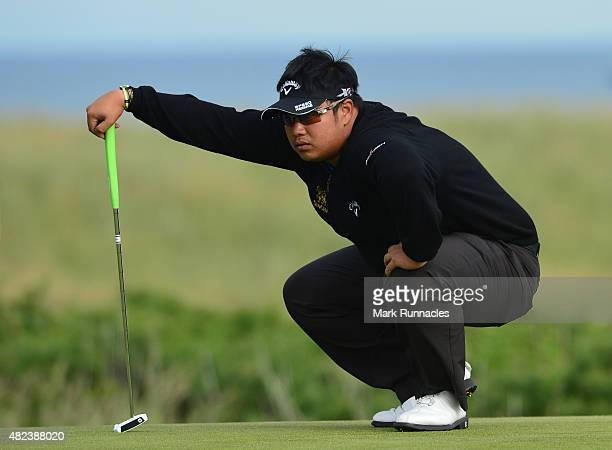 Kiradech Aphibarnrat of Thailand putting on the 19th hole during the first day of the Saltire Energy Paul Lawrie Matchplay at Murcar Links Golf Club...