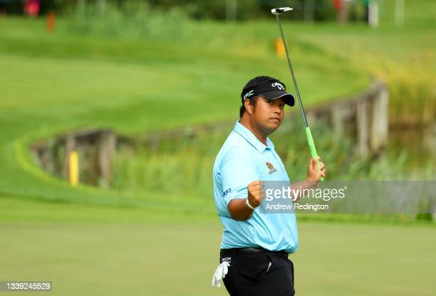 Kiradech Aphibarnrat of Thailand reacts after his putt on the 18th green during the first round of The BMW PGA Championship at Wentworth Golf Club on...