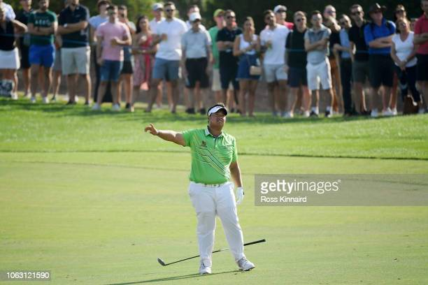 Kiradech Aphibarnrat of Thailand reacts after playing his second shot on the 8th hole during day four of the DP World Tour Championship at Jumeirah...