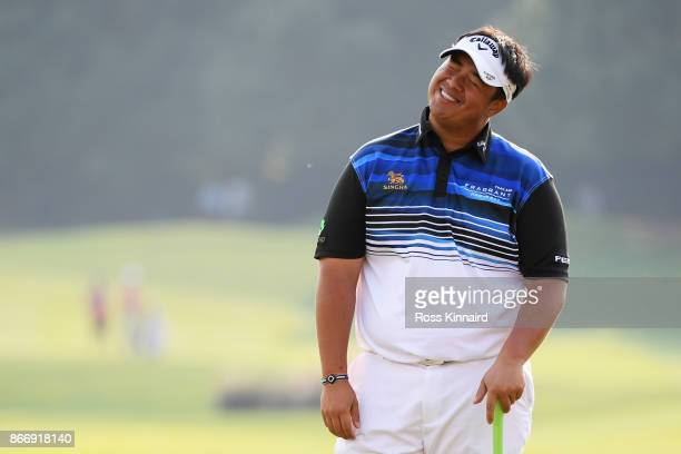 Kiradech Aphibarnrat of Thailand reacts on the 18th green during the second round of the WGC HSBC Champions at Sheshan International Golf Club on...