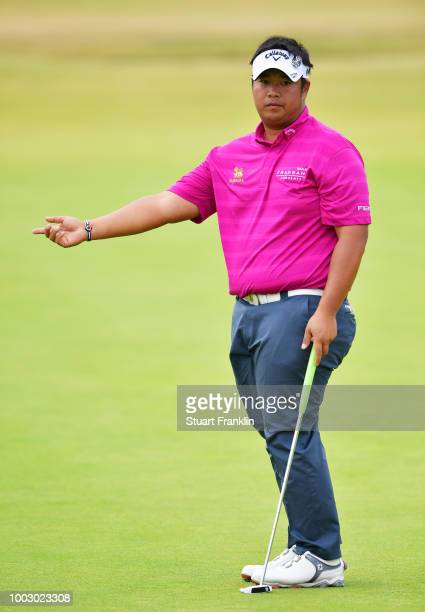 Kiradech Aphibarnrat of Thailand reacts to a putt on the 18th green during the third round of the 147th Open Championship at Carnoustie Golf Club on...