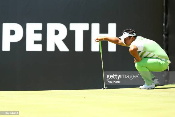 Kiradech Aphibarnrat of Thailand reads the 6th green in the round 2 match against Yusaku Miyazato of Japan during day four of the World Super 6 at...