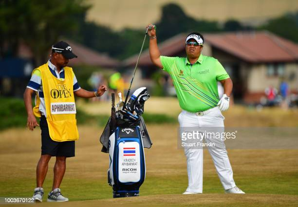 Kiradech Aphibarnrat of Thailand selects a club on the 12th hole during the final round of the 147th Open Championship at Carnoustie Golf Club on...