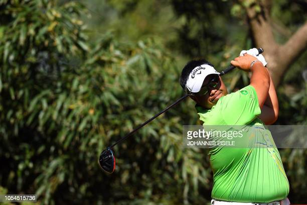 Kiradech Aphibarnrat of Thailand tees off during the final round of the WGCHSBC Champions golf tournament in Shanghai on October 28 2018
