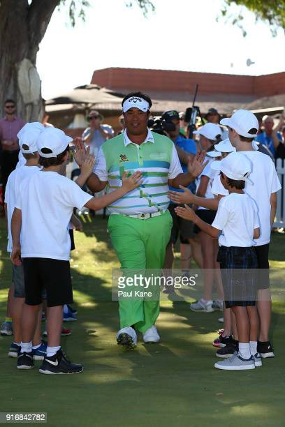 Kiradech Aphibarnrat of Thailand walks onto the 6th green thru a guard of honour after winning the final match against James Nitties of Australia...