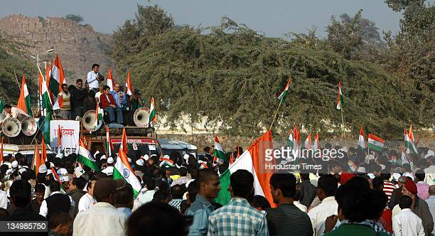 Kiran Bedi and Prashant Bhushan along with other Team Anna members holding a meeting at a ground near Tughlakabad fort after a car and bike rally...