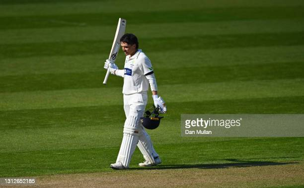 Kiran Carlson of Glamorgan celebrates reaching his century during day one of the LV= Insurance County Championship match between Glamorgan and Sussex...