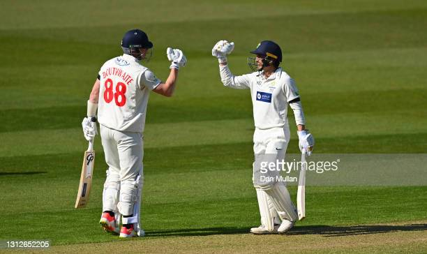 Kiran Carlson of Glamorgan celebrates with Dan Douthwaite after reaching his century during day one of the LV= Insurance County Championship match...