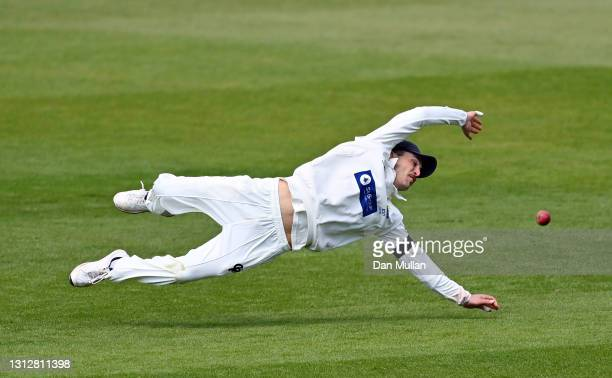 Kiran Carlson of Glamorgan dives in vain to stop a shot from Stiaan van Zyl of Sussex during day two of the LV= Insurance County Championship match...