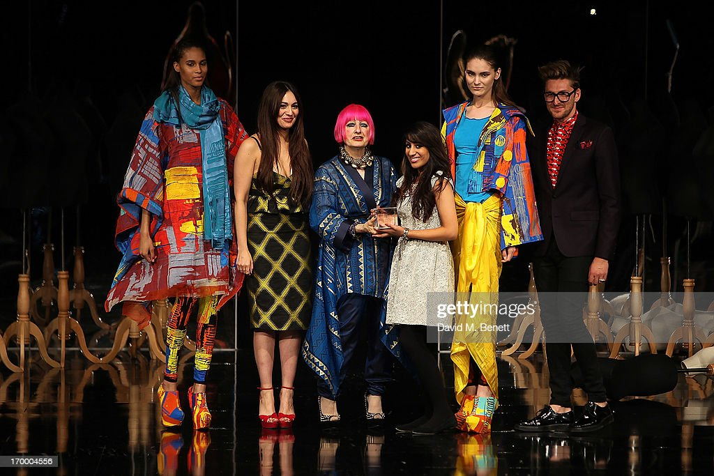 Kirandeep Bassan collects the award for Textiles from Zandra Rhodes at the gala awards show for Graduate Fashion Week 2013 at Earls Court 2 on June 5, 2013 in London, England.