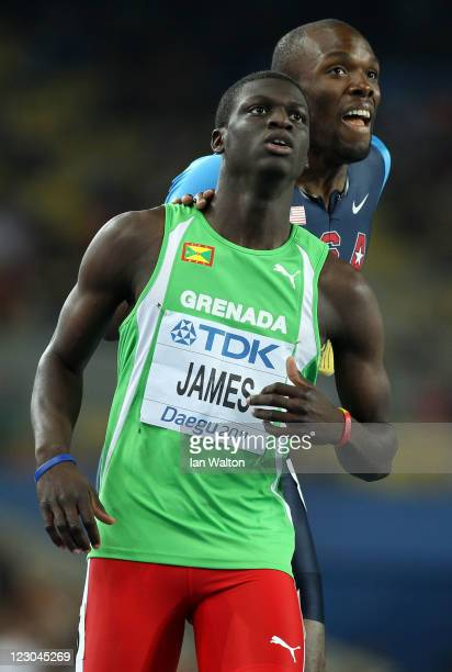 Kirani James of Grenada and LaShawn Merritt of United States look to the scoreboard after finishing the men's 400 metres final during day four of the...