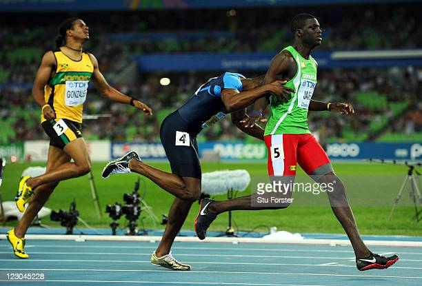 Kirani James of Grenada crosses the finish line ahead of LaShawn Merritt of United States and Jermaine Gonzales of Jamaica in the men's 400 metres...