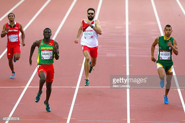 Kirani James of Grenada crosses the line to win gold ahead of Martyn Rooney of England and Wayde van Niekerk of South Africa in the Men's 400 metres...