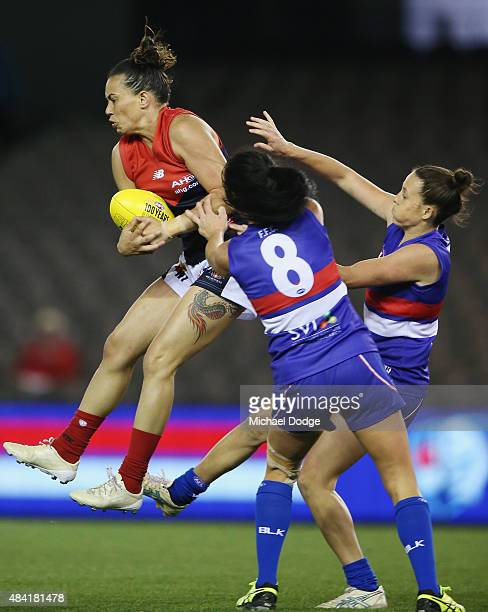 Kirby Bentley of the Demons marks the ball against Leah Kaslar of the Bulldogs during a Women's AFL exhibition match between Western Bulldogs and...