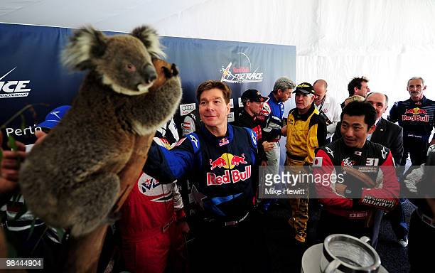 Kirby Chambliss of USA pets the koala at the official opening of the Race Airport during the Red Bull Air Race Preview day on April 14 2010 in Perth...