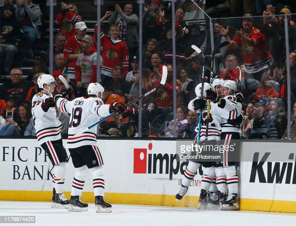 Kirby Dach Jonathan Toews Alex Nylander Slater Koekkoek and Adam Boqvist of the Chicago Blackhawks celebrate Boqvists firstperiod goal against the...